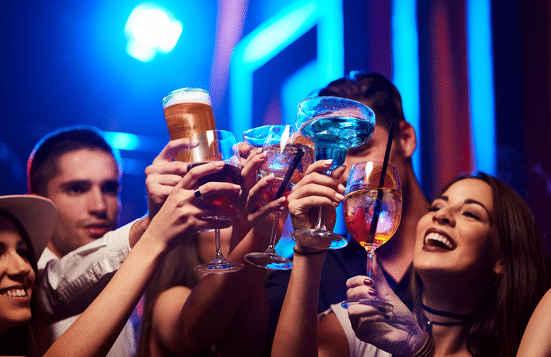 Group of people toasting glasses at Night club